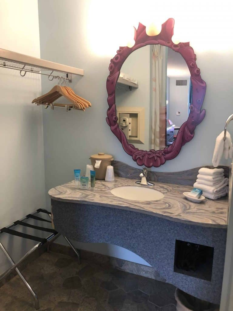 Sink and sea coral styled mirror inside the Art of Animation Little Mermaid room