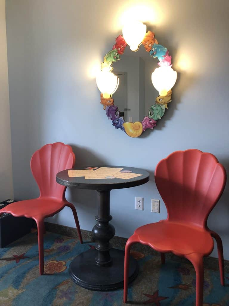 Table and chairs styled like clam shells  inside the Little Mermaid rooms as part of the Disney Art of Animation review