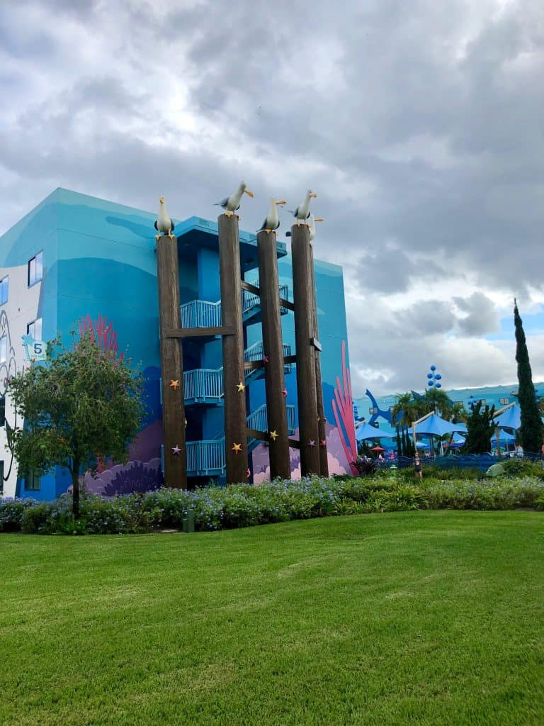 Art of Animation Finding Nemo theming with seagulls sitting on poles up the staircases