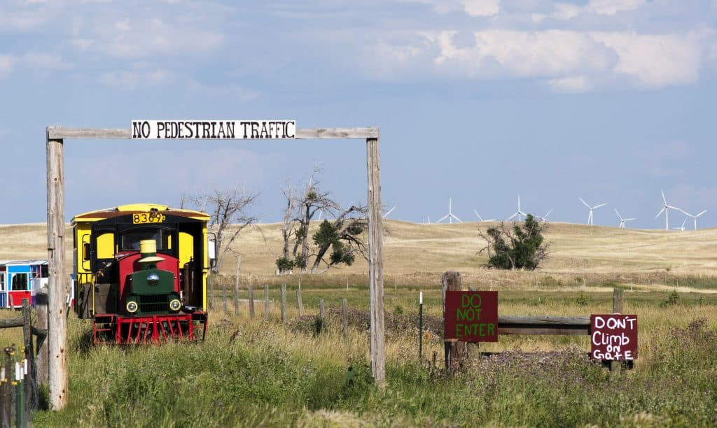Terry Bison Ranch Wyoming with train and signs in field