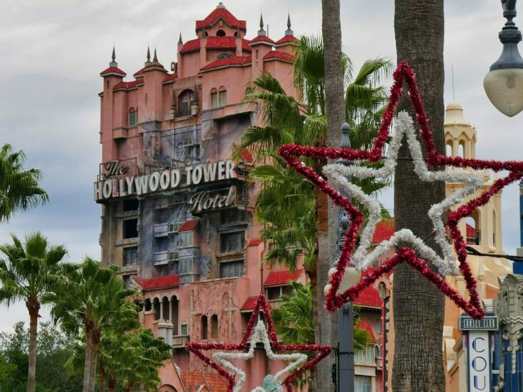 Hollywood Tower Hotel with Christmas decorations in front, including a large red and white star