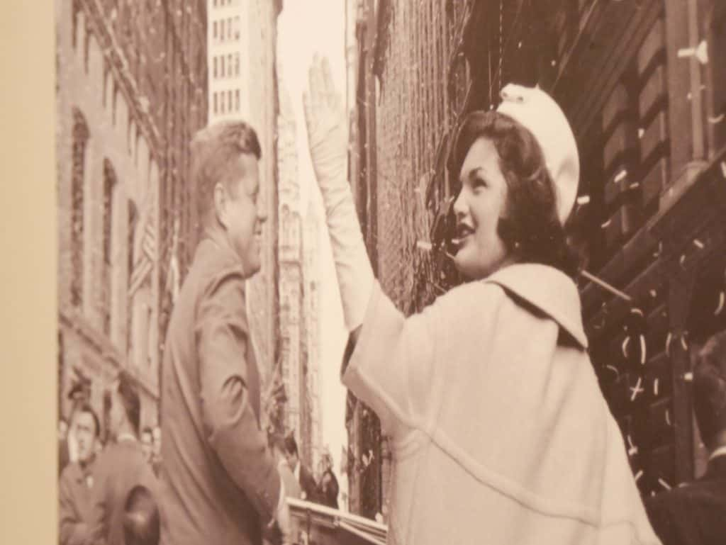 Photo of John F Kennedy and Jacqueline Kennedy with her waving