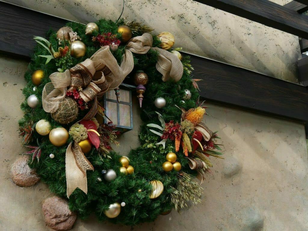A Christmas wreath on a wall at Animal Kingdom