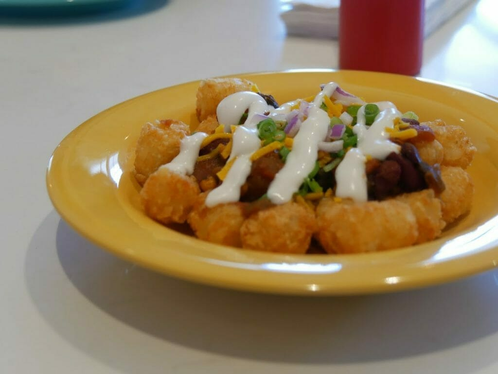 Tater tots on a yellow plate