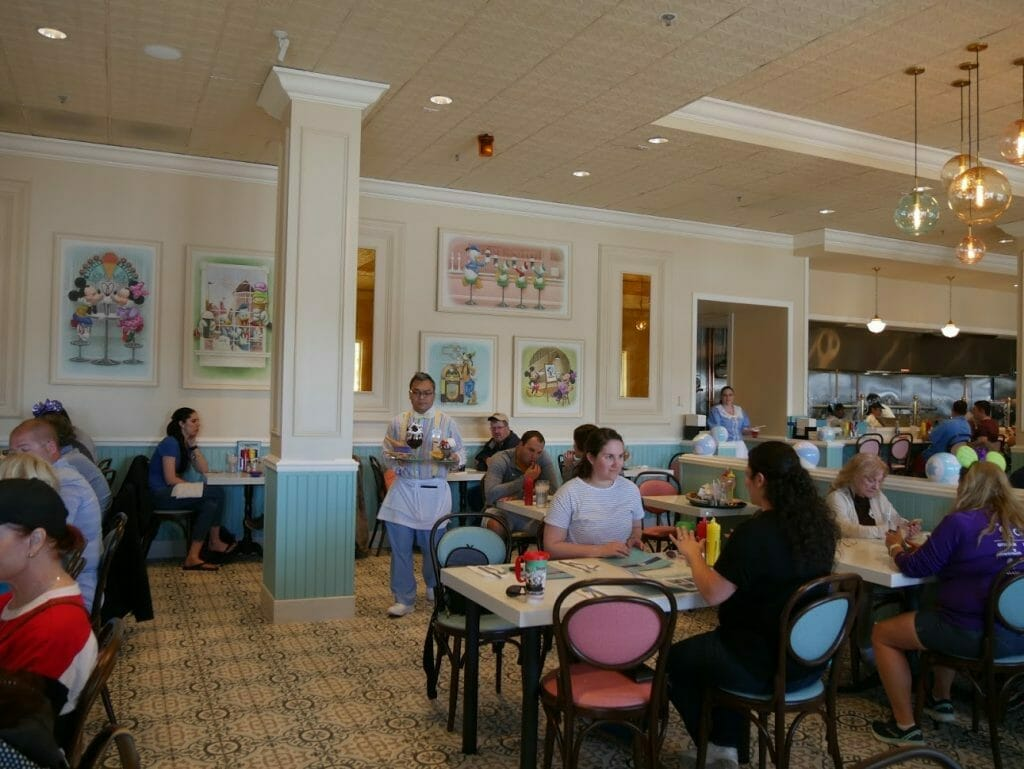 Interior of Beaches and Cream with people eating