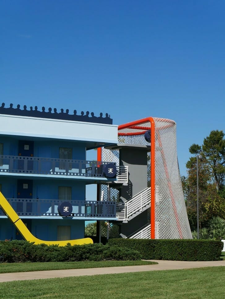 An ice hockey goal covering the stairs up a hotel building at Disney All-Star Movies