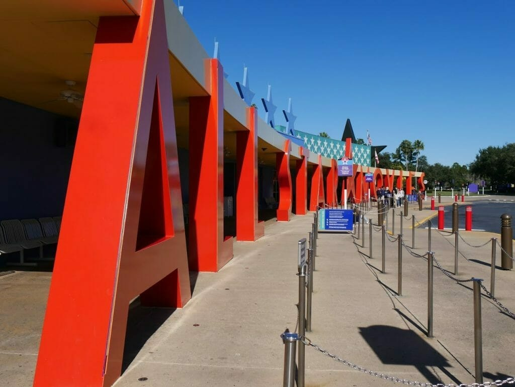 """All-Star Movies review bus transportation area with big red """"All-Star Movies"""" sign"""
