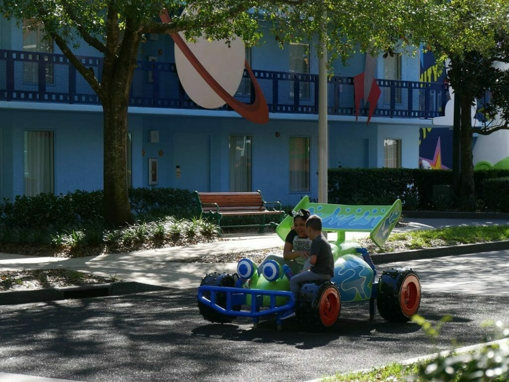 Disney All Star Movies resort Toy Story area with kids sitting on RC buggy