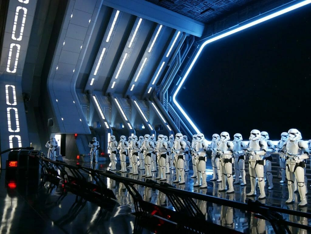 A Star Destroyer hanger with a group of Stormtroopers lined up