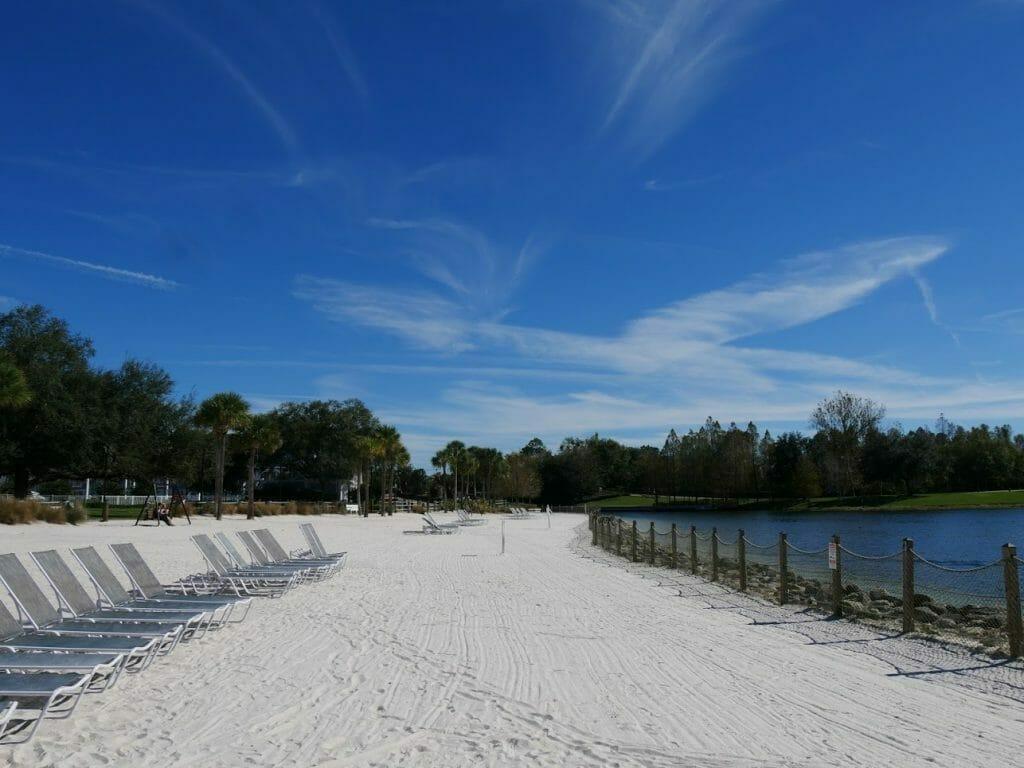 Deck chairs on a sandy beach at Beach Club resort