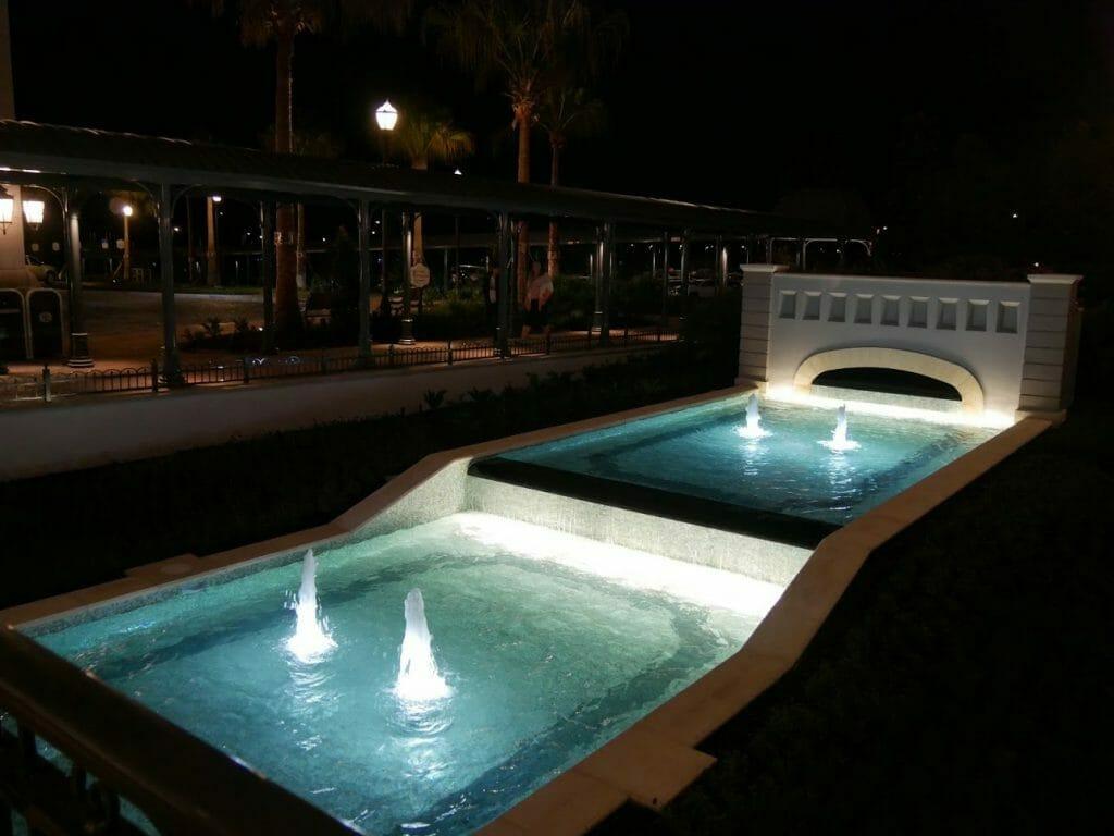 A water feature at night at Riviera Resort Disney World