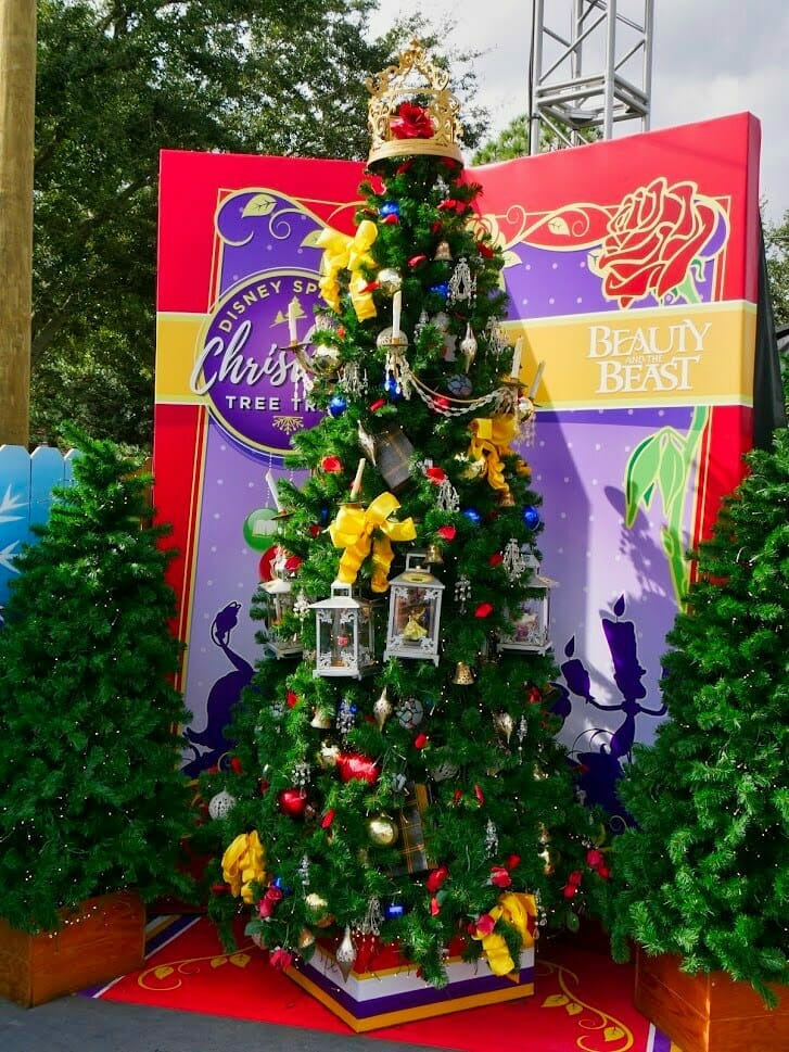 A Beauty and The Beast themed Christmas tree with fake snow falling