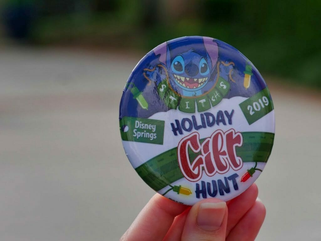 A Holiday Gift Hunt badge button from Disney Springs Christmas Tree walk