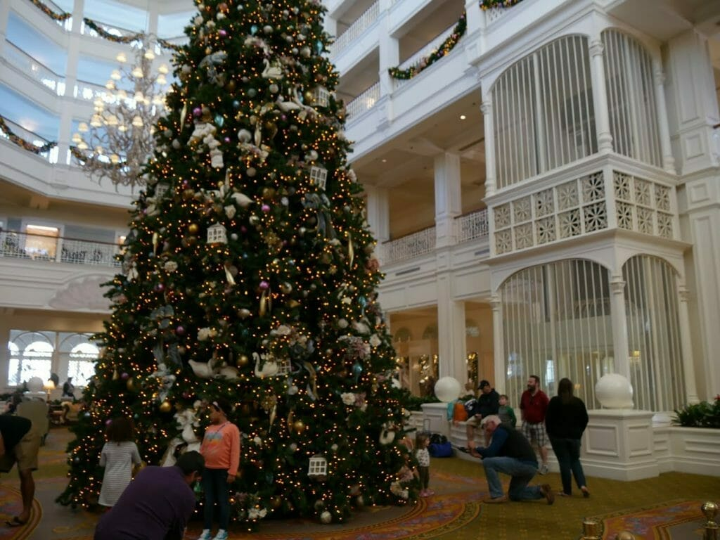 A large Christmas tree inside the Grand Floridian at Christmas at Disney World