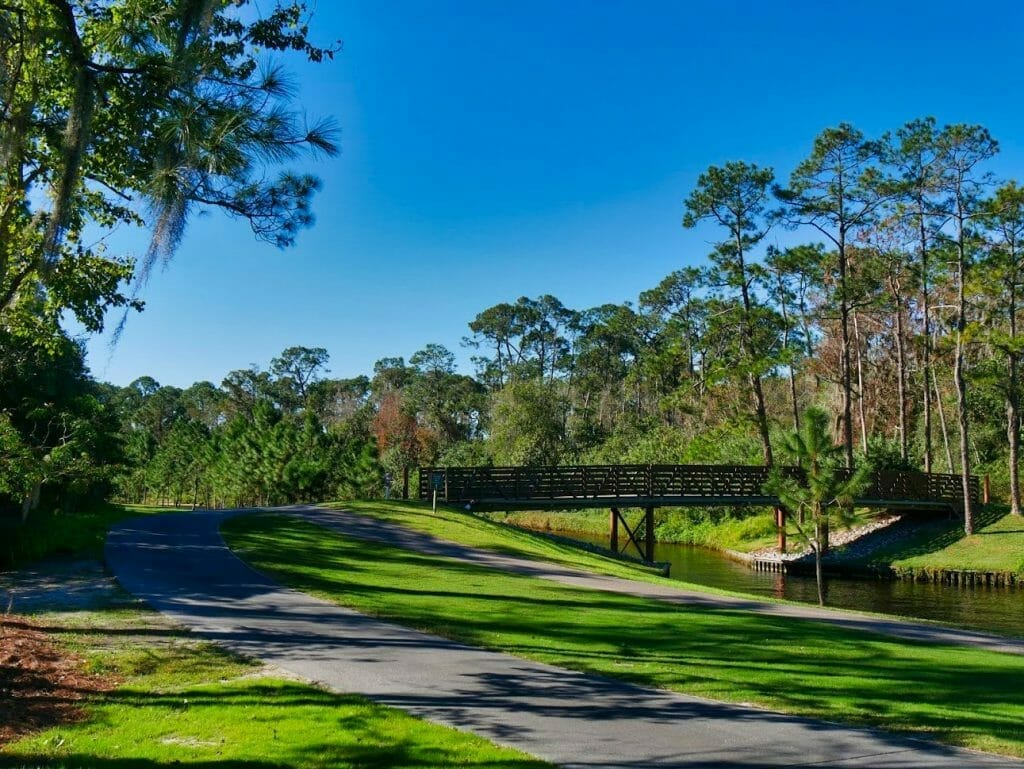 A jogging and walking path next to a golf course and river at Disney World