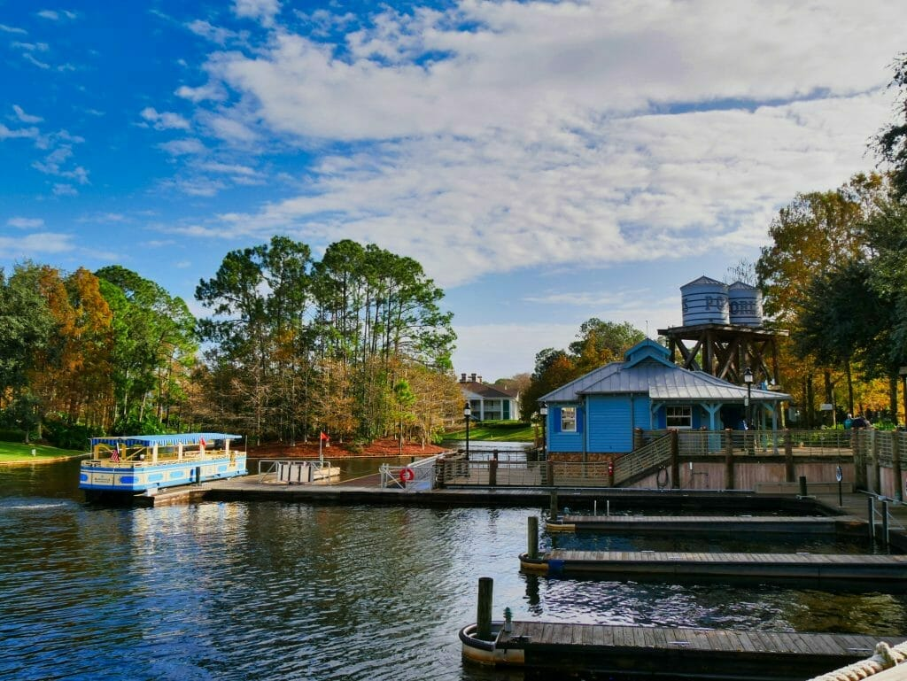Free Sassagoula River Cruise boat at Port Orleans Riverside with blue building and blue sky