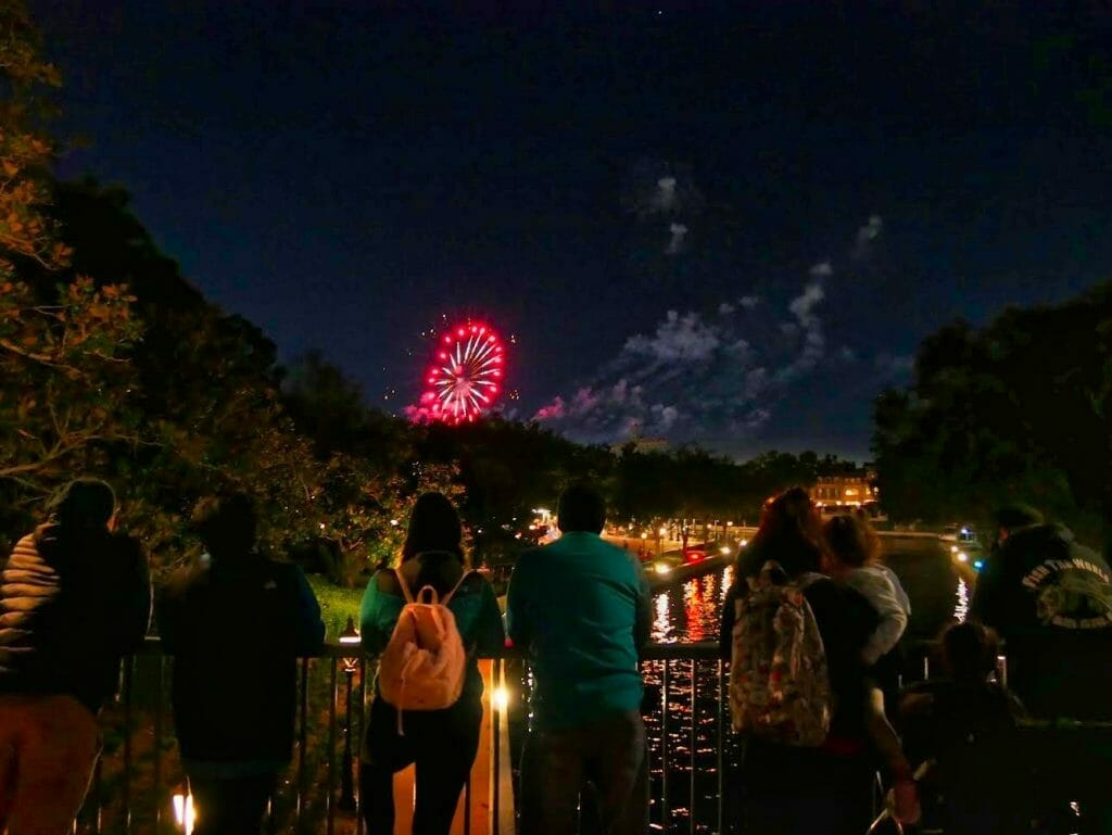 Epcot fireworks seen from a bridge next to the Beach Club resort at night