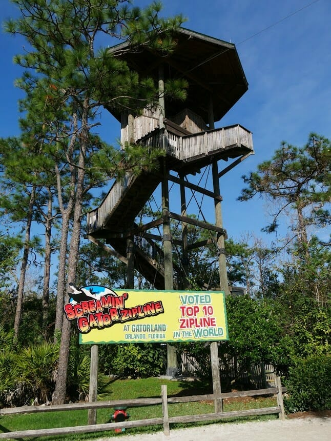 A high up wooden hut where people launch from for the Screamin' Gatorland zipline
