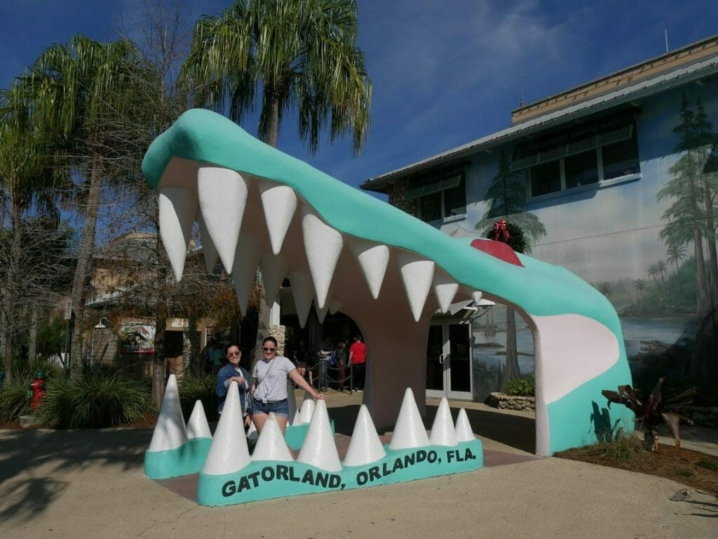 Entrance with a giant gator mouth with people smiling in it