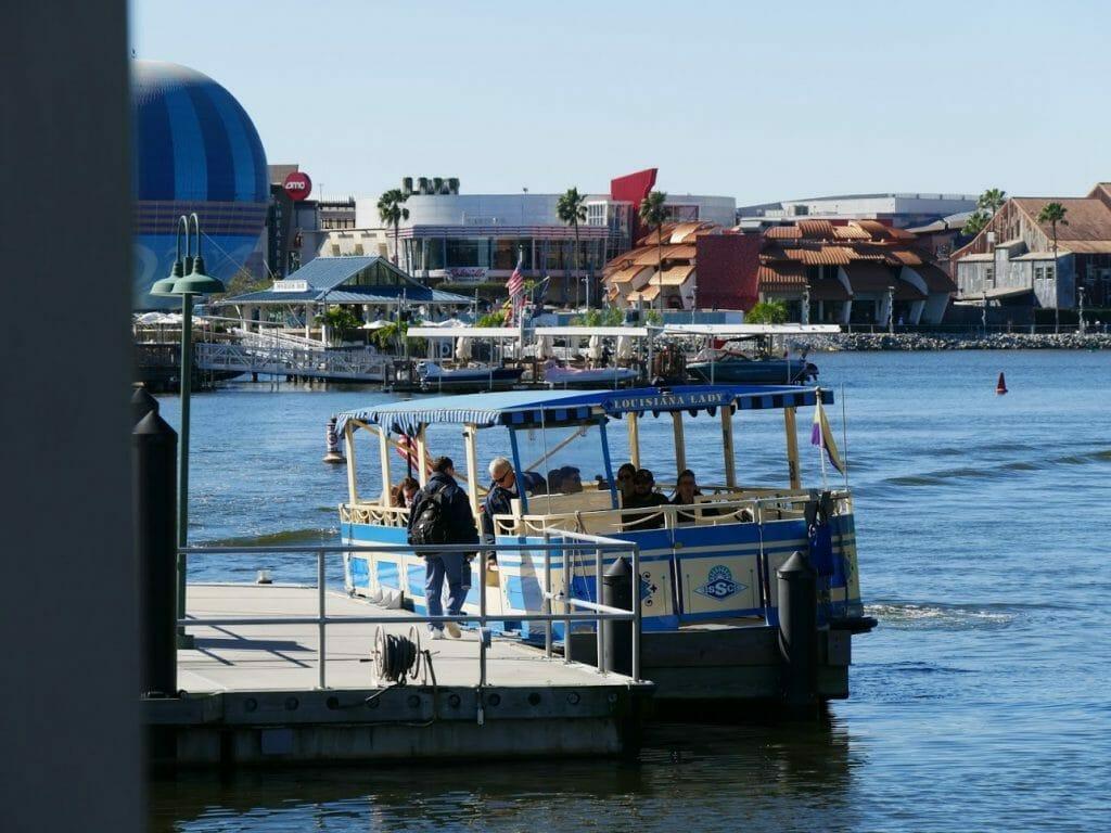 A boat docked at Disney Springs