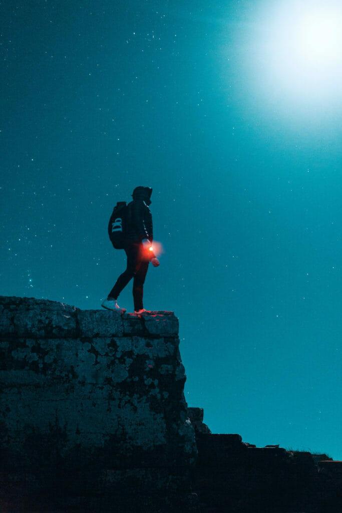 man with flashlight at night