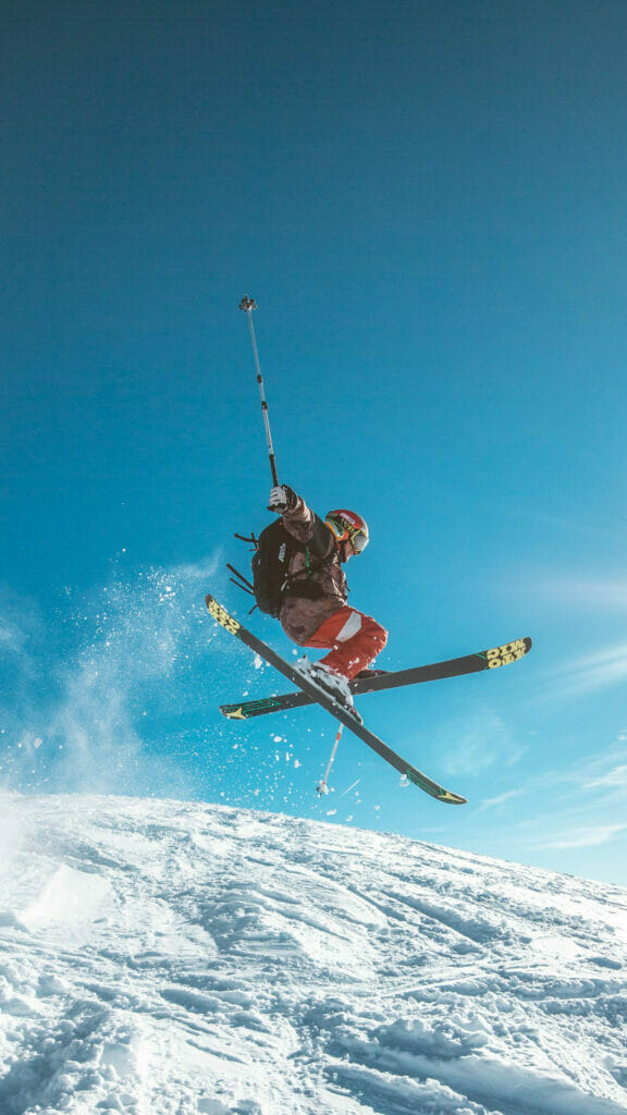 man skiing with blue sky behind him