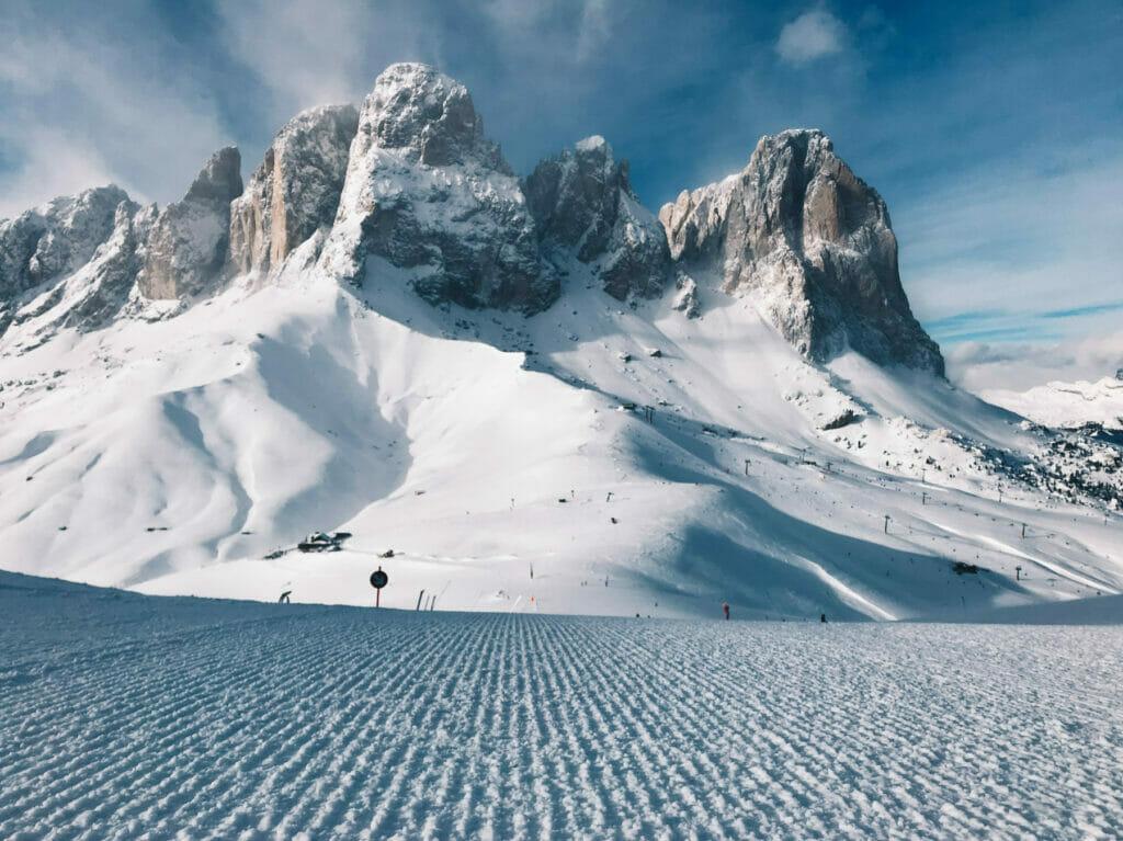 fresh ski run with mountains