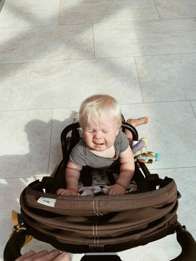 child crying in stroller